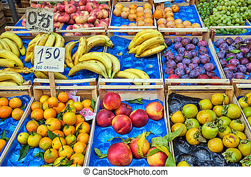 Fresh fruits in wooden boxes