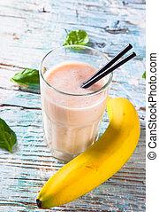 Fresh fruits milk shake on wood