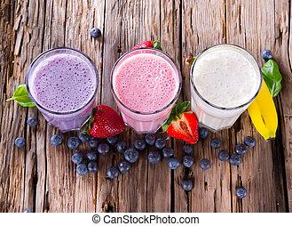 Fresh fruits milk shake on wood - Fresh milk, strawberry,...