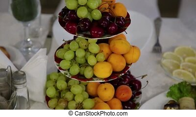 Fresh fruits on a banquet table. - Fresh fruits on a banquet...