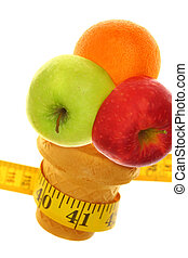 Fresh fruits on ice cream cup with tape measure