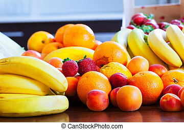 fresh fruits on kitchen table