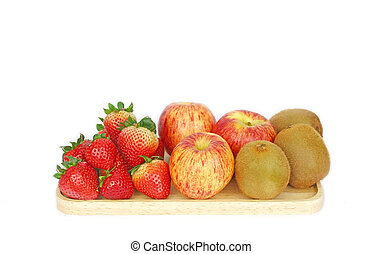 Fresh fruits on the wooden plate