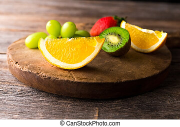 Fresh fruits on wooden background