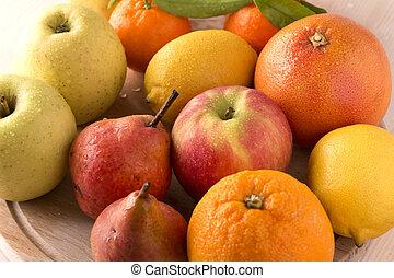 Fresh fruits on wooden board