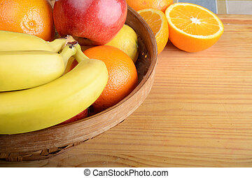 fresh fruits on wooden table.