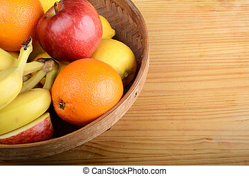 fresh fruits on wooden table. Healthy eating concept