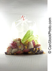 Fresh fruits salad in packing  on white