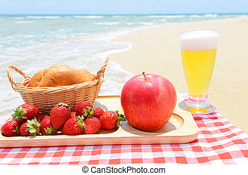 Fresh fruits with glass of beer