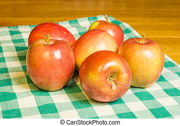 Fresh Fuji apples on a checked cloth