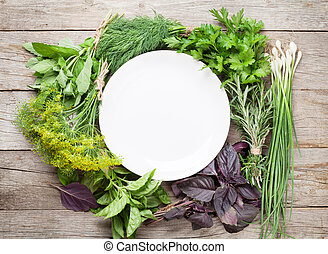 Fresh garden herbs and empty plate