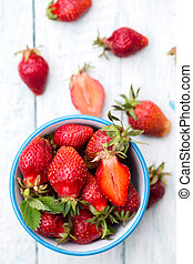 strawberries in a blue bowl