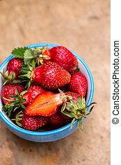 garden strawberries in a blue bowl