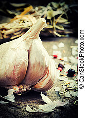 Fresh garlic and seasonings on wooden table