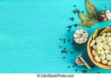 Fresh garlic heads, cloves set on a blue turquoise wooden surface, copy space