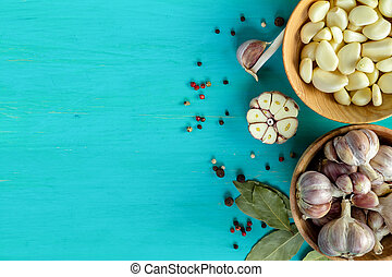 Fresh garlic heads, cloves set on a blue turquoise wooden...