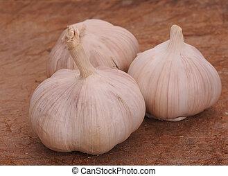 Fresh garlic on a wooden background