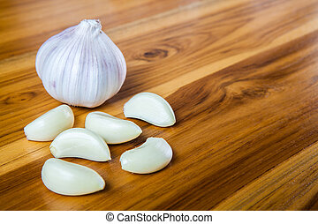 Fresh garlic on a wooden background.
