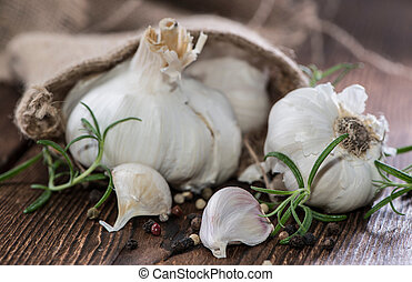 Fresh Garlic on vintage wooden background