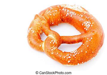 fresh German pretzel (Bretzel) with salt, with copy space.