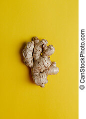 fresh Ginger root on yellow background. Top view