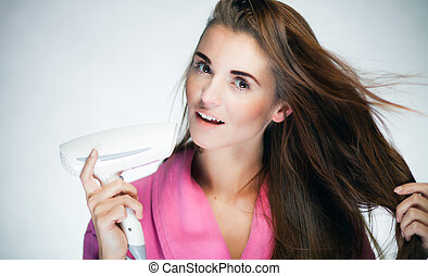 Fresh girl drying her long hair with blow dryer