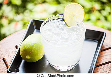Fresh glass of lime juice with lime