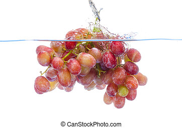 fresh grape dropped into water with splash isolated on white