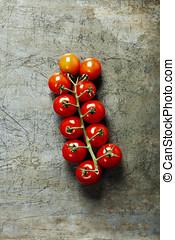 Fresh grape tomatoes on rystic background