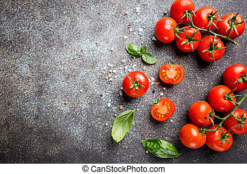 Fresh grape tomatoes with basil and coarse salt, top view...