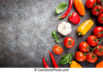 Fresh grape tomatoes with basil and pepper, top view with...