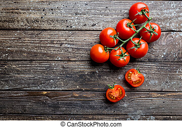 Fresh grape tomatoes with coarse salt, top view with copy...