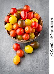 Fresh grape tomatoes with fresh basil.