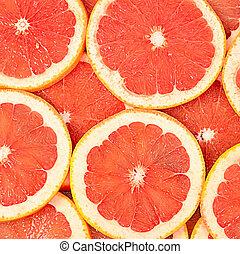 The fresh grapefruit as a background closeup