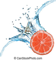 Fresh grapefruit dropped into water with bubbles isolated on white