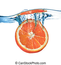 Fresh grapefruit dropped into water with splash isolated on white
