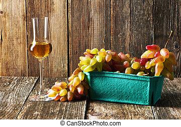 Fresh grapes and grappa - Fresh grapes and glass of grappa ...