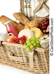 Fresh grapes and red currants in a picnic hamper - Fresh...