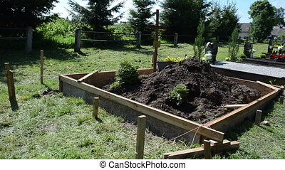 fresh grave cemetery soil - Freshly made grave soil and...