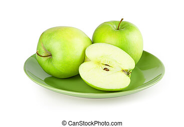 fresh green apple on a plate