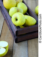 fresh green apples in a box