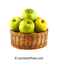 Fresh green apples in a wooden basket, isolated on white background.