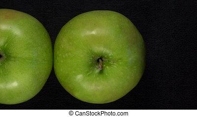 Fresh green apples on black background - Fresh green apples...