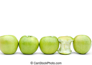 fresh green apples with one eaten apple
