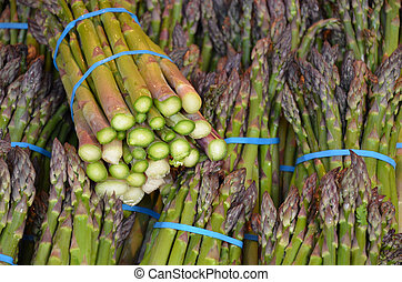 Fresh green asparagus at market
