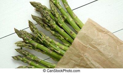 Fresh green asparagus in a brown paper bag. Healthy eating ...