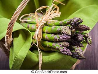 Fresh green asparagus in basket