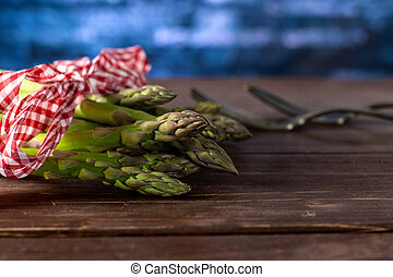 Fresh green asparagus spear on brown wood