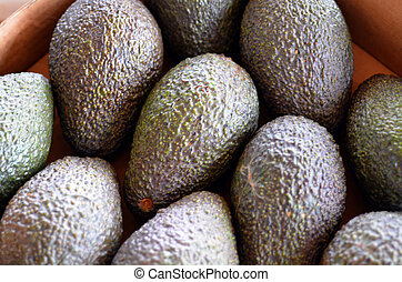Fresh green Avocado fruits in food market. Food background and texture