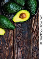 avocado - fresh green avocado on the wooden table